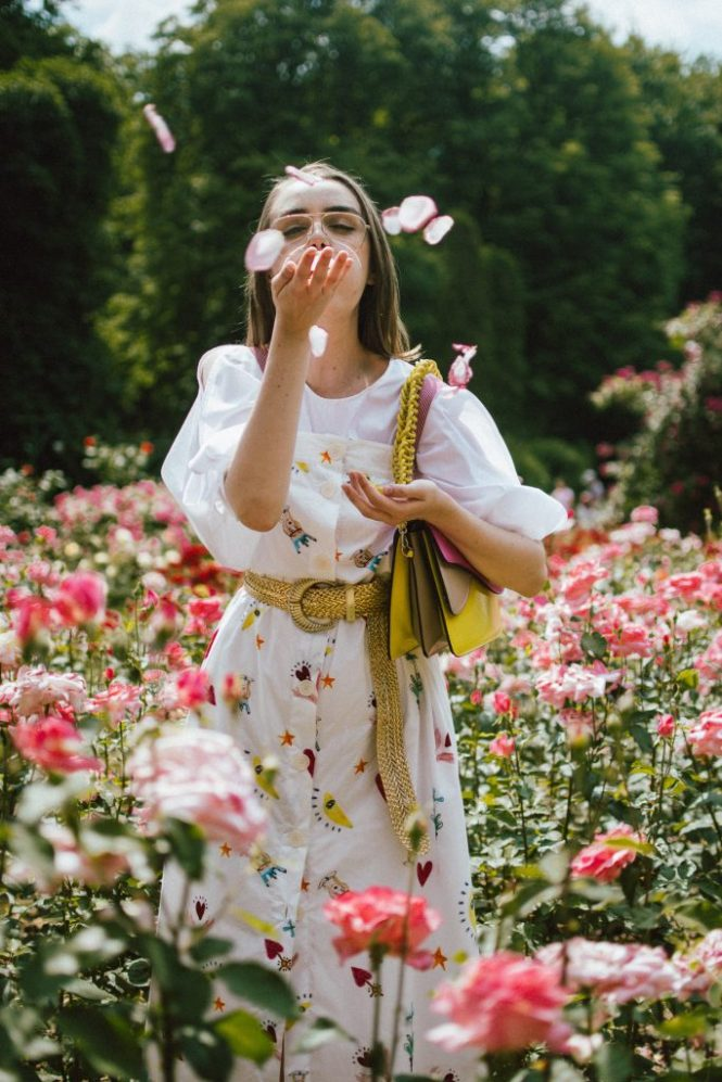 White puffy sleeves shirt, layered button front midi dress, gold metallic vintage belt, colorblock leather shoulder bag, pink mules, rose gorden editorial, andreea birsan, couturezilla, cute summer outfit ideas for 2018, step up your midi dress, how to wear a midi dress, printed dress, cotton dress, ottod'ame dress, rose gardens in bucharest, trandafiri bucuresti, gradina botanica, botanical garden, fun dress, cotton and linen, white shirt with puffy sleeves, the perfect midi dress for summer, marcie wconcept pink suede mules, korean shoes, korean mules, korean designer shoes, italian dress, beautiful bag, statement bag, yellow and pink shoulder bag, statement bag strap, isla fontaine bags, italian leather bags, how to layer a midi dress when it's melting outside, the midi dress you should wear this summer, how to wear a puffy sleeve top, white shirt, wardrobe must have, staples, how to look Parisian chic, European summer street style inspiration for women 2017, pinterest chic outfit ideas for woman, summer outfit ideas, summer ootd inspiration, outfit of the day, ootd, fashion icon, style inspiration, fashionista, fashion inspiration, style inspo, what to wear in summer, how to look French, chic on a budget, zara outfit, mango, topshop, asos, river island, forever 21, urban outfitters, how to mix high end pieces with luxury ones, zara and Gucci,outfit alternatives for summer, tomboy chic, minimal outfit, tumblr girls photos, pictures, happy girl, women, smart casual outfits, the best outfit ideas 2017, what to wear when you don't feel inspired, summer in Europe, weekend attire, uniform, French women in summer, European outfit ideas 2017, minimal chic outfit, how to stand out, the best outfit ideas for summer, the sunglasses you have seen everywhere on Instagram, glasses, uk fashion blogger, united kingdom, uk fashion blog, fashion and travel blog, Europe, women with style, street style, summer fashion trends 2017, best fashion ideas, styling, fall fashion, fall out