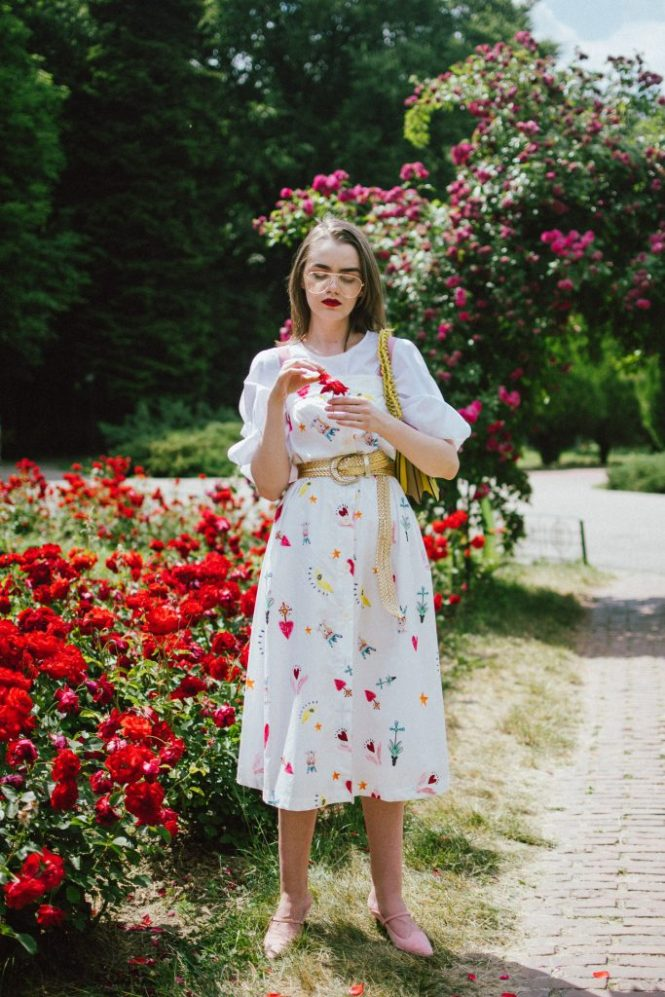 White puffy sleeves shirt, layered button front midi dress, gold metallic vintage belt, colorblock leather shoulder bag, pink mules, rose gorden editorial, andreea birsan, couturezilla, cute summer outfit ideas for 2018, step up your midi dress, how to wear a midi dress, printed dress, cotton dress, ottod'ame dress, rose gardens in bucharest, trandafiri bucuresti, gradina botanica, botanical garden, fun dress, cotton and linen, white shirt with puffy sleeves, the perfect midi dress for summer, marcie wconcept pink suede mules, korean shoes, korean mules, korean designer shoes, italian dress, beautiful bag, statement bag, yellow and pink shoulder bag, statement bag strap, isla fontaine bags, italian leather bags, how to layer a midi dress when it's melting outside, the midi dress you should wear this summer, how to wear a puffy sleeve top, white shirt, wardrobe must have, staples, how to look Parisian chic, European summer street style inspiration for women 2017, pinterest chic outfit ideas for woman, summer outfit ideas, summer ootd inspiration, outfit of the day, ootd, fashion icon, style inspiration, fashionista, fashion inspiration, style inspo, what to wear in summer, how to look French, chic on a budget, zara outfit, mango, topshop, asos, river island, forever 21, urban outfitters, how to mix high end pieces with luxury ones, zara and Gucci,outfit alternatives for summer, tomboy chic, minimal outfit, tumblr girls photos, pictures, happy girl, women, smart casual outfits, the best outfit ideas 2017, what to wear when you don't feel inspired, summer in Europe, weekend attire, uniform, French women in summer, European outfit ideas 2017, minimal chic outfit, how to stand out, the best outfit ideas for summer, the sunglasses you have seen everywhere on Instagram, glasses, uk fashion blogger, united kingdom, uk fashion blog, fashion and travel blog, Europe, women with style, street style, summer fashion trends 2017, best fashion ideas, styling, fall fashion, fall outfit, fall ootd, fall perfect, transitional dressing, best transitional outfit ideas, how to wear statement earrings, dressing for autumn, autumn outfit, winter outfit ideas for work and school 2017, clear lens aviator glasses, geeky glasses, clear lens glasses trend