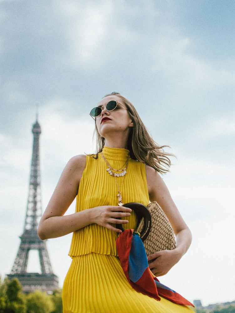 Massimo Dutti pleated yellow dress, gucci ace heart sneakers, paris, andreea birsan, couturezilla, cute summer outfit ideas for 2018, midi yellow dress, what to wear as a wedding guest, summer wedding guest dress, versatile wedding guest dresses, pleated dress, how to wear a midi dress, how to wear pleated dresses, dressed in dutti, massimo dutti dresses, yellow massimo dutti dress, dress and sneakers, gucci ace heart embroidered white leather sneakers, gucci trainers, the best gucci sneakers, shoes to invest in, should worth investing in, the best gucci sneakers, gucci kicks, white leather sneakers, durable sneakers, micro oval sunglasses, ray ban inspired sunglasses, straw bag, the best summer bags, mini bags, wood handle bag, striped scarf, tourist in paris, paris for a day, silk scarf, shell necklaces, gold layered necklaces, yellow dress to wear this summer, how to wear a dress with sneakers, sporty and chic outfit, half bun, wood handle handmade bag, the best summer bags, boho peach bag, eiffel tower photos, blogger photos from paris, the best views in paris, how to get a photo with the eiffel tower in the background, best photo spots in paris, instagram worthy spots in paris, france, travel blogger, european summer, summer vacation in paris, best instagram spots in paris, how to look Parisian chic, European summer street style inspiration for women 2017, pinterest chic outfit ideas for woman, summer outfit ideas, summer ootd inspiration, outfit of the day, ootd, fashion icon, style inspiration, fashionista, fashion inspiration, style inspo, what to wear in summer, how to look French, chic on a budget, zara outfit, mango, topshop, asos, river island, forever 21, urban outfitters, how to mix high end pieces with luxury ones, zara and Gucci,outfit alternatives for summer, tomboy chic, minimal outfit, tumblr girls photos, pictures, happy girl, women, smart casual outfits, the best outfit ideas 2017, what to wear when you don't feel inspired, summer in Europe, wee