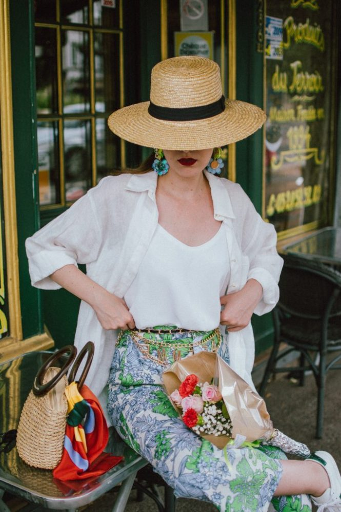 Zara floral print pants, flower print culottes, why you should wear floral print trousers, floral culottes, green blue and white pants, white cami top, mango camisole top, zara button down white linen shirt, boyfriend shirt, oversized shirt, gucci ace heart embroidered sneakers, gucci white sneakers, white leather sneakers, gucci trainers, h&m straw boater hat, summer straw bag with wooden handle, mini bag, the best summer bags, micro cat eye sunglasses, andreea birsan, couturezilla, cute summer outfit ideas 2018, sunnies, retro sunglasses, the asos sold out micro sunglasses, statement floral earrings, zara flower earrings, striped silk scarf, parisian cafe, andreea birsan travels to france, lille france, travel diary, what to wear when you travel to europe in summer, the perfect european summer outfit, how to wear a white shirt in different ways, handmade bags, bag made in thailand, wicker bag, natural fabric bag, how to wear florals, what to wear with floral printed pants, how to pull off culottes, what shoes to wear with culottes, tourist outfit, how to look Parisian chic, European summer street style inspiration for women 2017, pinterest chic outfit ideas for woman, summer outfit ideas, summer ootd inspiration, outfit of the day, ootd, fashion icon, style inspiration, fashionista, fashion inspiration, style inspo, what to wear in summer, how to look French, chic on a budget, zara outfit, mango, topshop, asos, river island, forever 21, urban outfitters, how to mix high end pieces with luxury ones, zara and Gucci,outfit alternatives for summer, tomboy chic, minimal outfit, tumblr girls photos, pictures, happy girl, women, smart casual outfits, the best outfit ideas 2017, what to wear when you don't feel inspired, summer in Europe, weekend attire, uniform, French women in summer, European outfit ideas 2017, minimal chic outfit, how to stand out, the best outfit ideas for summer, the sunglasses you have seen everywhere on Instagram, glasses, uk fashion blogger, united kingdom, uk fashion blog, fashion and travel blog, Europe, women with style, street style, summer fashion trends 2017, best fashion ideas, styling, fall fashion, fall outfit, fall ootd, fall perfect, transitional dressing, best transitional outfit ideas, how to wear statement earrings, dressing for autumn, autumn outfit, winter outfit ideas for work and school 2017