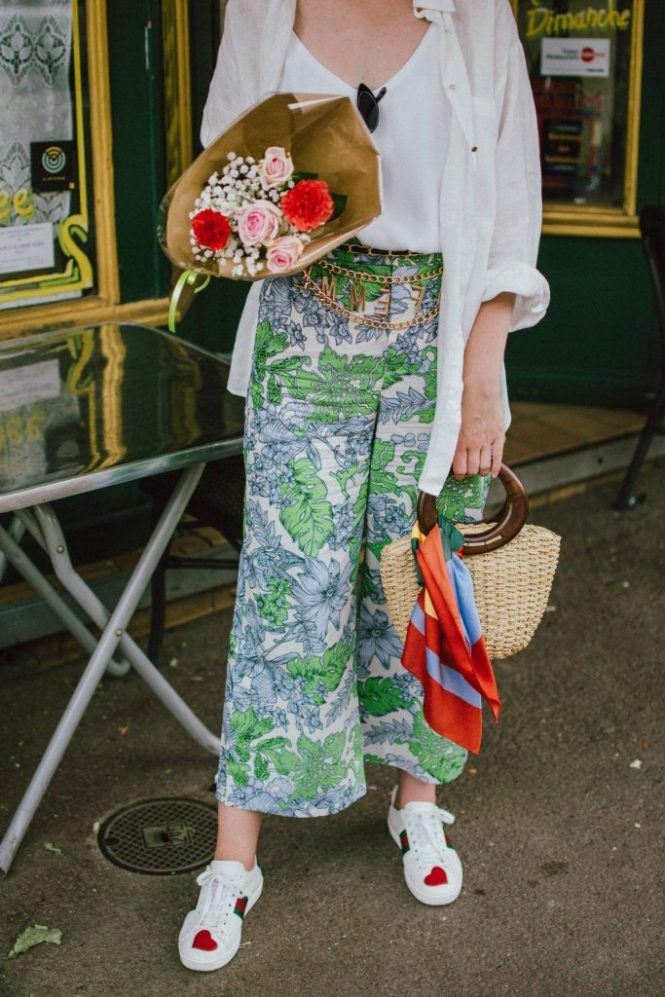 Zara floral print pants, flower print culottes, why you should wear floral print trousers, floral culottes, green blue and white pants, white cami top, mango camisole top, zara button down white linen shirt, boyfriend shirt, oversized shirt, gucci ace heart embroidered sneakers, gucci white sneakers, white leather sneakers, gucci trainers, h&m straw boater hat, summer straw bag with wooden handle, mini bag, the best summer bags, micro cat eye sunglasses, andreea birsan, couturezilla, cute summer outfit ideas 2018, sunnies, retro sunglasses, the asos sold out micro sunglasses, statement floral earrings, zara flower earrings, striped silk scarf, parisian cafe, andreea birsan travels to france, lille france, travel diary, what to wear when you travel to europe in summer, the perfect european summer outfit, how to wear a white shirt in different ways, handmade bags, bag made in thailand, wicker bag, natural fabric bag, how to wear florals, what to wear with floral printed pants, how to pull off culottes, what shoes to wear with culottes, tourist outfit, how to look Parisian chic, European summer street style inspiration for women 2017, pinterest chic outfit ideas for woman, summer outfit ideas, summer ootd inspiration, outfit of the day, ootd, fashion icon, style inspiration, fashionista, fashion inspiration, style inspo, what to wear in summer, how to look French, chic on a budget, zara outfit, mango, topshop, asos, river island, forever 21, urban outfitters, how to mix high end pieces with luxury ones, zara and Gucci,outfit alternatives for summer, tomboy chic, minimal outfit, tumblr girls photos, pictures, happy girl, women, smart casual outfits, the best outfit ideas 2017, what to wear when you don't feel inspired, summer in Europe, weekend attire, uniform, French women in summer, European outfit ideas 2017, minimal chic outfit, how to stand out, the best outfit ideas for summer, the sunglasses you have seen everywhere on Instagram, glasses, uk fashion blogger, unit