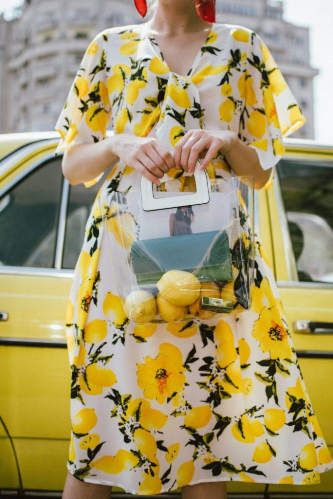 Lemon print midi dress, yellow slingback shoes, transparent tote bag, andreea birsan, couturezilla, cute summer outfit ideas 2018, lemon print dress, tie front lemon print dress, sicialian print, why you should wear a fruit print this summer, the prints that are hot right now, the best holiday dress, what you should wear on a summer holiday, warm weather midi dress, yellow and white midi tie front dress, top knot dress, vinyl tote bag, staud inspired bag, how to wear yellow, lemons, fruit print clothing, d&g inspired print dress, lemon printed dress, how to wear a midi dress, what shoes to wear with a midi dress, yellow suede slingback shoes, yellow kitten heel shoes, slingbacks, yellow shoes, how to pull off yellow shoes, the transparent bag trend, pcv bag, celine inspired plastic bag trend, the best bags from mango, silk striped scarf, scarf in hair, how to style a scarf in your ponytail, how to wear a scarf, best summer dresses, how to look Parisian chic, European summer street style inspiration for women 2017, pinterest chic outfit ideas for woman, summer outfit ideas, summer ootd inspiration, outfit of the day, ootd, fashion icon, style inspiration, fashionista, fashion inspiration, style inspo, what to wear in summer, how to look French, chic on a budget, zara outfit, mango, topshop, asos, river island, forever 21, urban outfitters, how to mix high end pieces with luxury ones, zara and Gucci,outfit alternatives for summer, tomboy chic, minimal outfit, tumblr girls photos, pictures, happy girl, women, smart casual outfits, the best outfit ideas 2017, what to wear when you don't feel inspired, summer in Europe, weekend attire, uniform, French women in summer, European outfit ideas 2017, minimal chic outfit, how to stand out, the best outfit ideas for summer, the sunglasses you have seen everywhere on Instagram, glasses, uk fashion blogger, united kingdom, uk fashion blog, fashion and travel blog, Europe, women with style, street style, summer fashion trends 2017