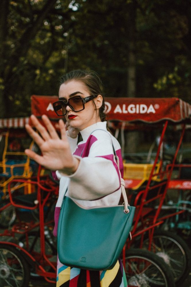Zara pink trench coat, rainbow midi skirt, turtleneck sweater, mywalit bag, white shoes, andreea birsan, couturezilla, cute fall outfit ideas 2018, stripe midi skirt, topshop rainbow skirt, multi color skirt, how to wear a rainbow skirt, striped mango sweater, how to wear pink and purple, purple and white turtleneck sweater, cozy sweater, balloon sleeve sweater, chunky knit, white leather pumps, white leather high heel shoes, how to wear white shoes, striped skirt, how to wear double stripes, italian leather bag, pastel green bag, big gucci inspired sunglasses, tortoise sunglasses, autumn layers, pink mac, pink autumn coat, how to wear a pink coat, what colors to wear with pink, washed grey bag, teal bag, knot detail bag, mywalit teal hobo bag with knot detail, colorful fall outfit 2018, how to wear colors in autumn, how to look Parisian chic, European summer street style inspiration for women 2017, pinterest chic outfit ideas for woman, summer outfit ideas, summer ootd inspiration, outfit of the day, ootd, fashion icon, style inspiration, fashionista, fashion inspiration, style inspo, what to wear in summer, how to look French, chic on a budget, zara outfit, mango, topshop, asos, river island, forever 21, urban outfitters, how to mix high end pieces with luxury ones, zara and Gucci,outfit alternatives for summer, tomboy chic, minimal outfit, tumblr girls photos, pictures, happy girl, women, smart casual outfits, the best outfit ideas 2017, what to wear when you don't feel inspired, summer in Europe, weekend attire, uniform, French women in summer, European outfit ideas 2017, minimal chic outfit, how to stand out, the best outfit ideas for summer, the sunglasses you have seen everywhere on Instagram, glasses, uk fashion blogger, united kingdom, uk fashion blog, fashion and travel blog, Europe, women with style, street style, summer fashion trends 2017, best fashion ideas, styling, fall fashion, fall outfit, fall ootd, fall perfect, transitional dressing, best transitional outfit ideas, how to wear statement earrings, dressing for autumn, autumn outfit, winter outfit ideas for work and school