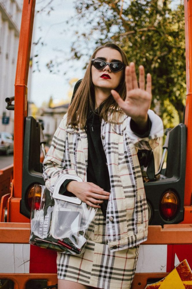 Boohoo denim checked yellow suit, mini skirt, black sock heel boots, transparet bag, nike hoodie, andreea birsan, couturezilla stret style, cute fall outfit ideas 2018, washed yellow check denim skirt, washed yellow check denim mini skirt, how to wear check printed denim, oversized yellow denim jacket, boyfriend fit jacket for women, how to wear an oversized denim jacket, denim jacket and oversized hoodie, black boyfriend nike hoodie, basic black hoodie and denim outfit, how to wear sock boots like a pro, the affordable version of the balenciaga knife sock boots, pointy toe high heel sock boots, mango transparent bag, staud sally bag dupe, staud bags, black cat eye sunglasses, moschino inspired black cat eye sunglasses, how to rock the transparent bag trend, vinyl bag, how to wear double denim, canadian tuxedo 2018 fall outfit, how to wear the check print, how to look Parisian chic, European summer street style inspiration for women 2017, pinterest chic outfit ideas for woman, summer outfit ideas, summer ootd inspiration, outfit of the day, ootd, fashion icon, style inspiration, fashionista, fashion inspiration, style inspo, what to wear in summer, how to look French, chic on a budget, zara outfit, mango, topshop, asos, river island, forever 21, urban outfitters, how to mix high end pieces with luxury ones, zara and Gucci,outfit alternatives for summer, tomboy chic, minimal outfit, tumblr girls photos, pictures, happy girl, women, smart casual outfits, the best outfit ideas 2017, what to wear when you don't feel inspired, summer in Europe, weekend attire, uniform, French women in summer, European outfit ideas 2017, minimal chic outfit, how to stand out, the best outfit ideas for summer, the sunglasses you have seen everywhere on Instagram, glasses, uk fashion blogger, united kingdom, uk fashion blog, fashion and travel blog, Europe, women with style, street style, summer fashion trends 2017, best fashion ideas, styling, fall fashion, fall outfit, fall ootd, fall perfect, transitional dressing, best transitional outfit ideas, how to wear statement earrings, dressing for autumn, autumn outfit, winter outfit ideas for work and school