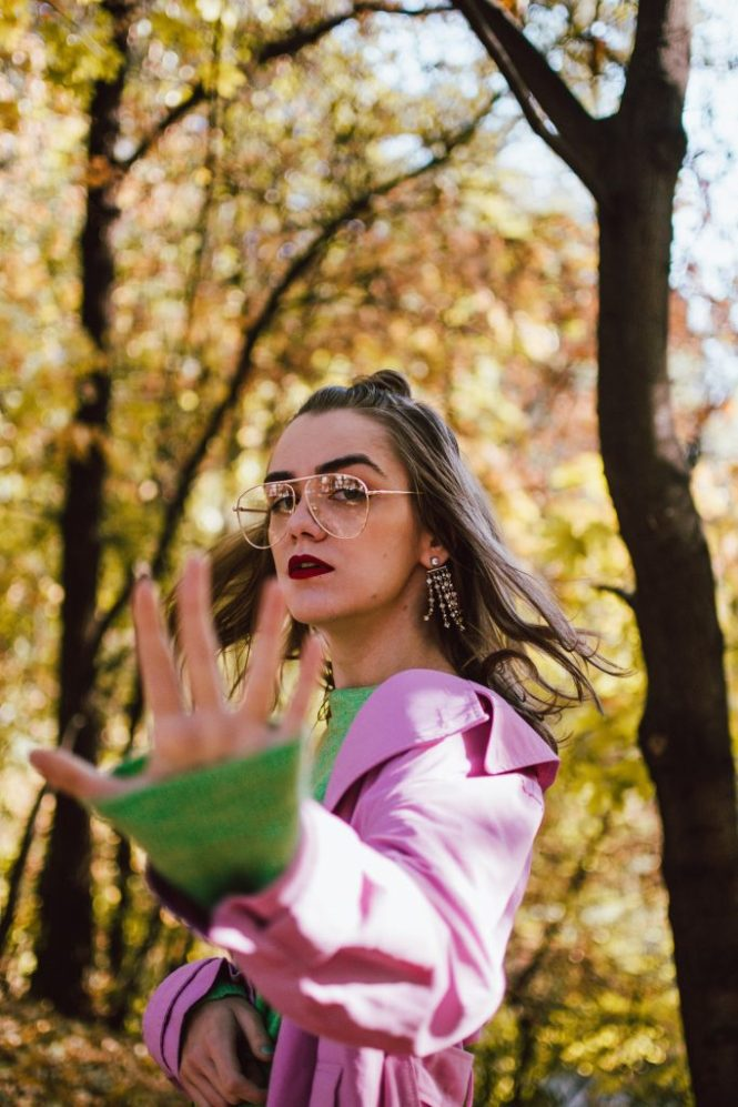How to look fashionable on a very strict budget, pink trench coat, green asymmetric polka dot skirt, green sweater, andreea birsan street style, couturezilla, cute fall outfit ideas 2018, how to wear green from head to toe, green fall outfit, autumn green outfit for women 2018, how to pull off an all green outfit, soft green knit, green sweater, green knitwear, light green sweater, midi skirt with dots and stripes, statement skirt, topshop skirt, topshop style, high street finds, green and white midi asymmetric skirt with dots and stripes, polka dot skirt, striped skirt, how to wear polka dots, how to wear a polka dot skirt and a sweater, polka dot skirt and green sweater, green skirt and green sweater, midi skirt and sneakers, how to wear skirts with sneakers, pink and green outfit, color block outfit, zara pink trench coat, how to wear a colorful trench coat, how to wear pink, how to wear a pink trench coat, pink trench coat fall outfit 2018, pink trench coat and green skirt and sweater, trench coat weather, trench coat street style outfit, gucci ace heart embroidered sneakers, whie leather gucci sneakers, gucci trainers, gucci white kicks, how to pull off white sneakers and skirts, autumn layers, warm autumn outfit, black moschino inspired cat eye sunglasses, clear lens glasses, fall in the park, green leather shoulder prada bag with studs and stones, prada green leather bag, statement bag, how to look Parisian chic, European summer street style inspiration for women 2017, pinterest chic outfit ideas for woman, summer outfit ideas, summer ootd inspiration, outfit of the day, ootd, fashion icon, style inspiration, fashionista, fashion inspiration, style inspo, what to wear in summer, how to look French, chic on a budget, zara outfit, mango, topshop, asos, river island, forever 21, urban outfitters, how to mix high end pieces with luxury ones, zara and Gucci,outfit alternatives for summer, tomboy chic, minimal outfit, tumblr girls photos, pictures, happy girl, wome