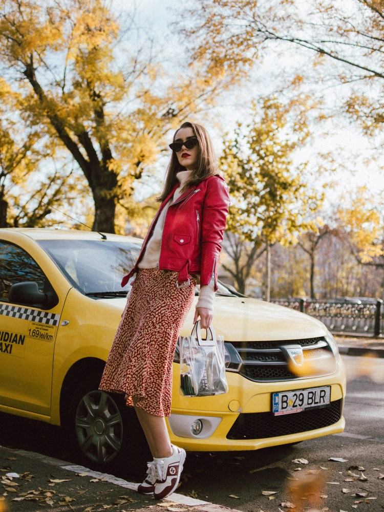 Boohoo satin midi leopard print skirt, mohair turtleneck sweater, gucci sneakers, transparent bag, red leather biker jacket, andreea birsan, couturezilla, cute fall outfit ideas 2018. beige and red midi leopard print skirt, how to wear a midi skirt, what to wear with leopard print, what colors go with animal print, cappuccino turtleneck sweater, light beige cashmere sweater, the best women's sweaters from h&m, how to layer in fall, red leather jacket and turtleneck sweater outfit, leather jacket and midi skirt, mango vinyl tote, staud inspired transparent tote bag, the pvc bag trend, is it worth getting a transparent bag, how to wear the transparent trend bag, outfits to wear to work in autumn 2018, work fall outfits 2018, gucci colorblock ugly sneakers, gucci two tone dad sneakers, gucci chunky sneakers, how to wear chunky sneakers with skirts, moschino inspired black cat eye sunglasses with studs, layer knits with leather jackets, red genuine leather biker jacket, mango red leather moto jacket, fitted leather jacket, edgy fall outfit with skirts and sweaters, how to look Parisian chic, European summer street style inspiration for women 2017, pinterest chic outfit ideas for woman, summer outfit ideas, summer ootd inspiration, outfit of the day, ootd, fashion icon, style inspiration, fashionista, fashion inspiration, style inspo, what to wear in summer, how to look French, chic on a budget, zara outfit, mango, topshop, asos, river island, forever 21, urban outfitters, how to mix high end pieces with luxury ones, zara and Gucci,outfit alternatives for summer, tomboy chic, minimal outfit, tumblr girls photos, pictures, happy girl, women, smart casual outfits, the best outfit ideas 2017, what to wear when you don't feel inspired, summer in Europe, weekend attire, uniform, French women in summer, European outfit ideas 2017, minimal chic outfit, how to stand out, the best outfit ideas for summer, the sunglasses you have seen everywhere on Instagram, glasses, uk fashion blogger, united kingdom, uk fashion blog, fashion and travel blog, Europe, women with style, street style, summer fashion trends 2017, best fashion ideas, styling, fall fashion, fall outfit, fall ootd, fall perfect, transitional dressing, best transitional outfit ideas, how to wear statement earrings, dressing for autumn, autumn outfit, winter outfit ideas for work and school