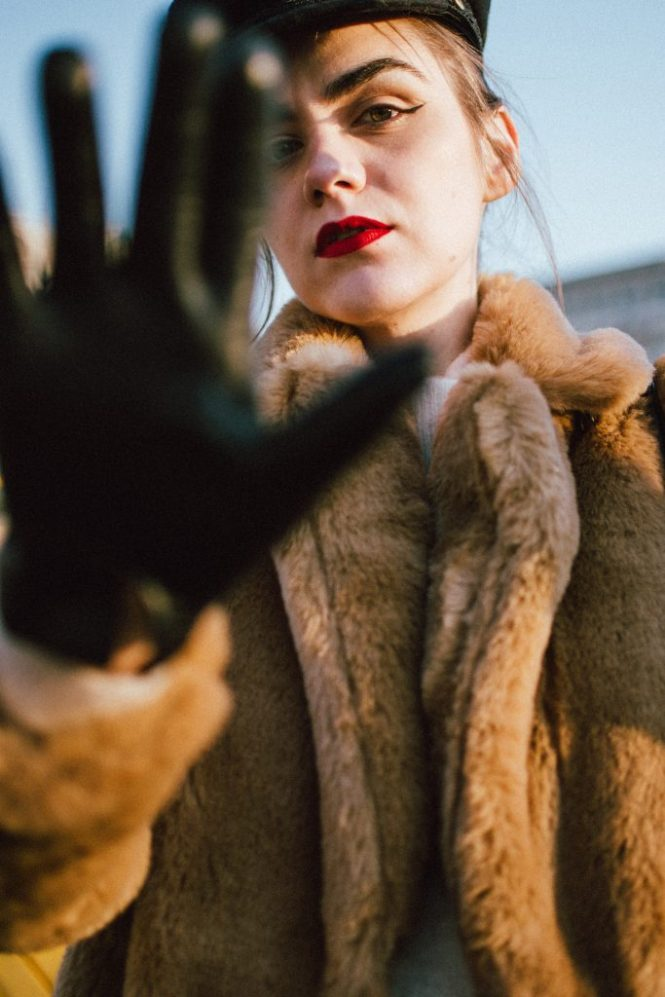 Beige faux fur coat, copper trousers, cashmere turtleneck sweater, white leather boots, andreea birsan streetstyle, couturezilla, cute winter outfit ideas 2018, where to find the best faux fur coat on the market, italian faux fur coat, luxe looking coat, midi length faux fur coat, how to style a faux fur coat, neutral tones outfit, copper straight leg trousers, how to wear white leather boots, white boots, combat white boots, military white boots for women, black baker boy hat, cavalli class statement bag with stripes and eyelets, beige cashmere turtleneck sweater, how to wear cashmere sweaters, where to find the best cashmere sweater, shades of beige winter outfit, beige winter outfit ideas, genuine leather chanel gloves, statement bag in red white and black, how to stay warm in winter, cozy and warm winter coats, fashionable and warm winter coats, how to wear beige, what other colors to wear with beige, avoid wearing black in winter, a non black winter outfit, how to look Parisian chic, European summer street style inspiration for women 2017, pinterest chic outfit ideas for woman, summer outfit ideas, summer ootd inspiration, outfit of the day, ootd, fashion icon, style inspiration, fashionista, fashion inspiration, style inspo, what to wear in summer, how to look French, chic on a budget, zara outfit, mango, topshop, asos, river island, forever 21, urban outfitters, how to mix high end pieces with luxury ones, zara and Gucci,outfit alternatives for summer, tomboy chic, minimal outfit, tumblr girls photos, pictures, happy girl, women, smart casual outfits, the best outfit ideas 2017, what to wear when you don't feel inspired, summer in Europe, weekend attire, uniform, French women in summer, European outfit ideas 2017, minimal chic outfit, how to stand out, the best outfit ideas for summer, the sunglasses you have seen everywhere on Instagram, glasses, uk fashion blogger, united kingdom, uk fashion blog, fashion and travel blog, Europe, women with style, street st