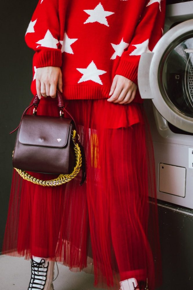 Oversized red star sweater, red tulle midi skirt, white leather boots, burgundy bag, beret, cute winter outfit ideas 2018, andreea birsan street style, couturezilla, star printed sweater, oversized sweater with stars, midi tulle skirt, oversized sweater and tulle skirt combo, how to wear an all red winter outfit, all red outfit, white leather military boots, combat boots, how to wear white boots, genuine leather boots, dark red leather bag, isla fontaine lady bag, burgundy lady bag, italian leather bags, colorful stockings, how to wear red tights, how to dress in winter and stay warm, winter layers, how to wear an all red outfit and not be cold in winter, color alternatives to wearing black in winter, celine inspired letter necklace, A pendant necklace, gold necklace, how to wear a beret, how to style a beret, wavy hair and beret, how to look chic in an all red outfit, french chic winter outfit, feminine skirt with military boots, edgy winter outfit, chic outfit ideas for winter,  how to look Parisian chic, European summer street style inspiration for women 2017, pinterest chic outfit ideas for woman, summer outfit ideas, summer ootd inspiration, outfit of the day, ootd, fashion icon, style inspiration, fashionista, fashion inspiration, style inspo, what to wear in summer, how to look French, chic on a budget, zara outfit, mango, topshop, asos, river island, forever 21, urban outfitters, how to mix high end pieces with luxury ones, zara and Gucci,outfit alternatives for summer, tomboy chic, minimal outfit, tumblr girls photos, pictures, happy girl, women, smart casual outfits, the best outfit ideas 2017, what to wear when you don't feel inspired, summer in Europe, weekend attire, uniform, French women in summer, European outfit ideas 2017, minimal chic outfit, how to stand out, the best outfit ideas for summer, the sunglasses you have seen everywhere on Instagram, glasses, uk fashion blogger, united kingdom, uk fashion blog, fashion and travel blog, Europe, women with style, street style, summer fashion trends 2017, best fashion ideas, styling, fall fashion, fall outfit, fall ootd, fall perfect, transitional dressing, best transitional outfit ideas, how to wear statement earrings, dressing for autumn, autumn outfit, winter outfit ideas for work and school