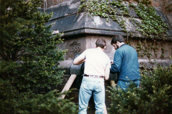 Technicians preparing to X ray the corner stone