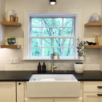 modern traditional kitchen with farmhouse sink, brass faucet and open shelving