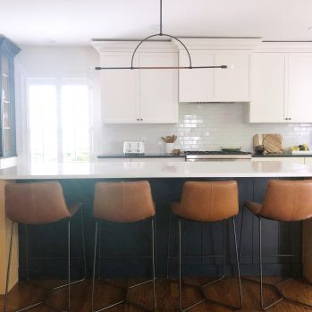 modern traditional kitchen with island and leather stools