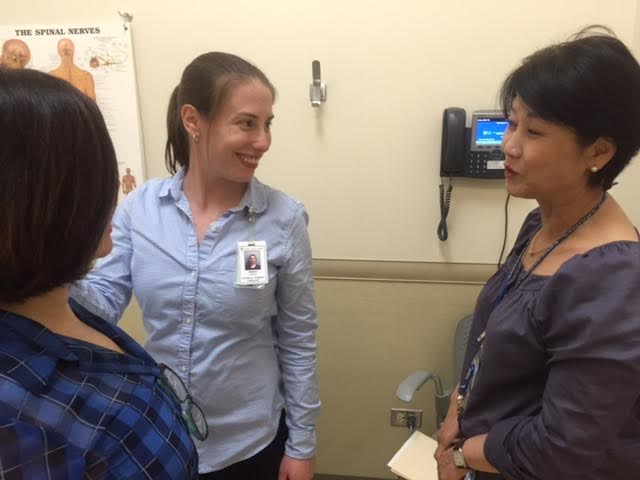 Kyung Yu provides translation services for hospital staff and Korean-speaking patients.