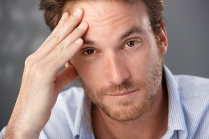 Closeup portrait of troubled man looking at camera, worried.