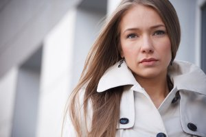serious woman in a coat