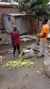 David witnessing to a woman shucking corn