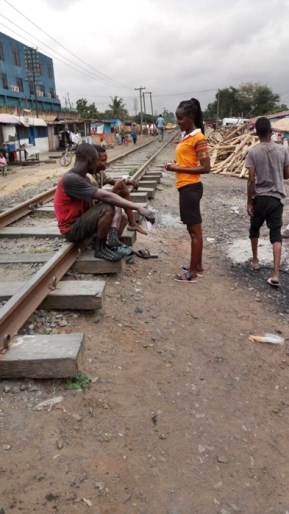 Della witnessing to two men on railroad tracks