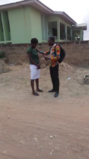 Bro. David praying for a lady - Kwabenya - Oct 2017