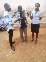 Bro. David praying with a man
