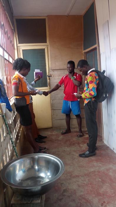 Praying with a man - Kwabenya