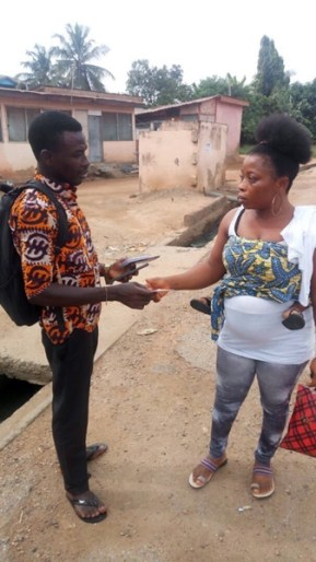 David giving tract to a lady