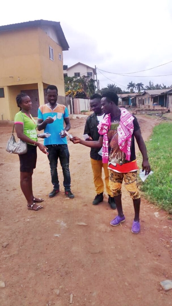Giving tracts to three men