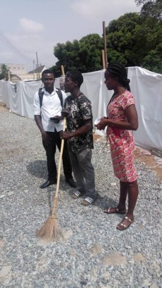 Team witnessing to a man with a broom
