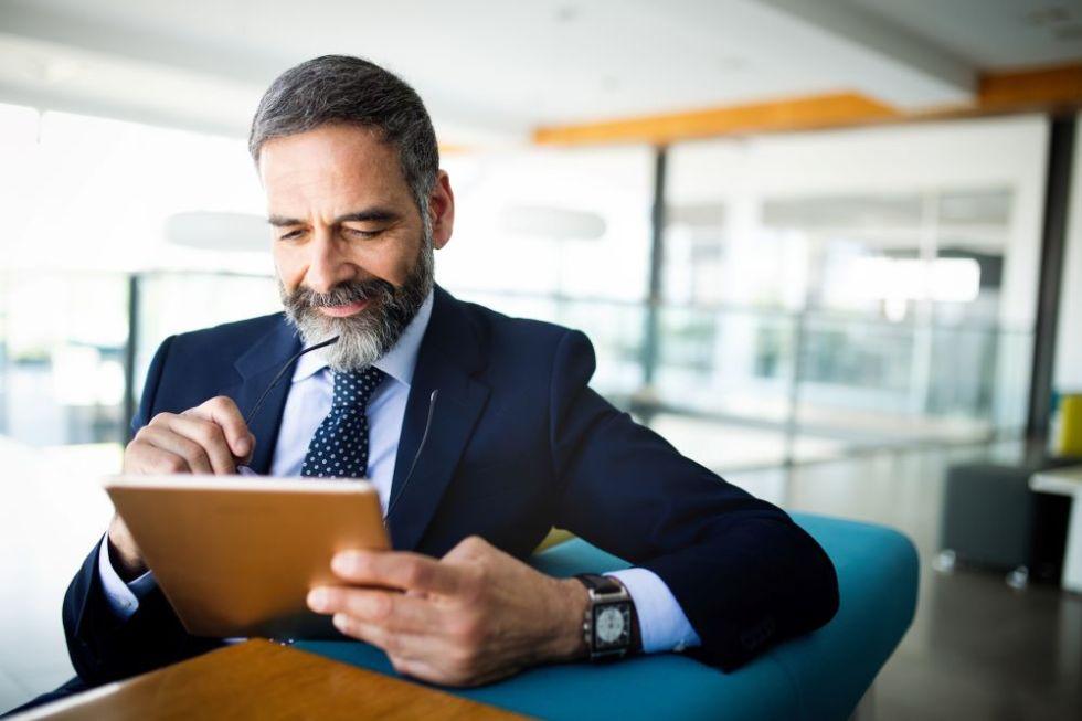 Man looking through marketing services on ipad.