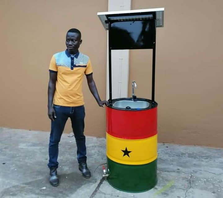 Mr. Richard Kwarteng Anning with his touchless solar hand washing machine