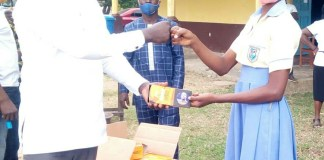 NPP Parliamentary Candidate for Asutifi North, Patrick Banor (Left) presenting Mathematical set to students
