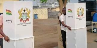 Electoral Commission (EC) officials arranging election materials