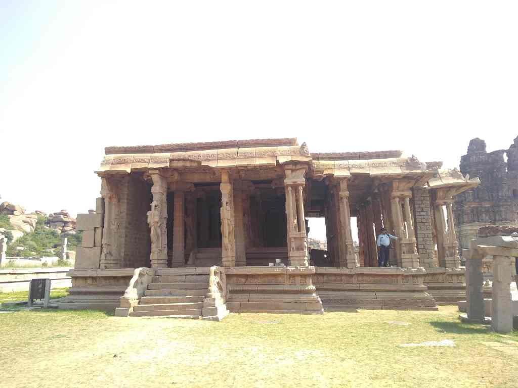 One of the structures at Vittala Temple with cracks almost falling towards the left.