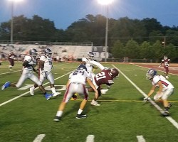 Mount Vernon running back surrounded by defenders after long run