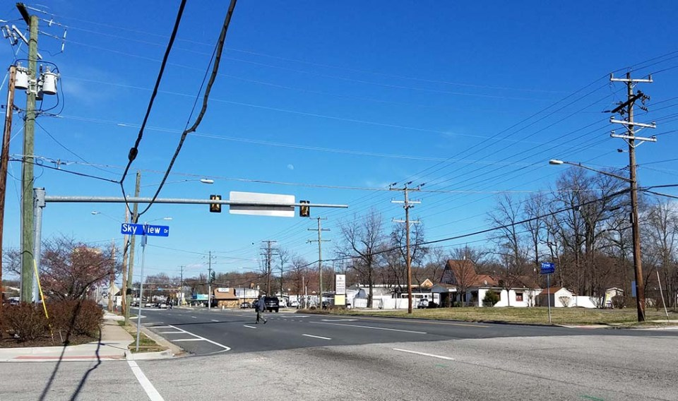 Intersection of Sky View Drive and Richmond Highway with power lines showing on both sides