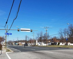power lines over Route 1 and next to road