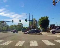 Cyclist struck, on ground