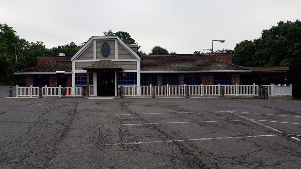 Restaurant exterior and empty parking lot