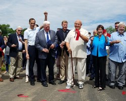 Pols and residents cutting the ribbon at the Huntington Levee