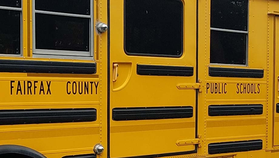 "Side of school bus with ""Fairfax County Public Schools"" in letters"