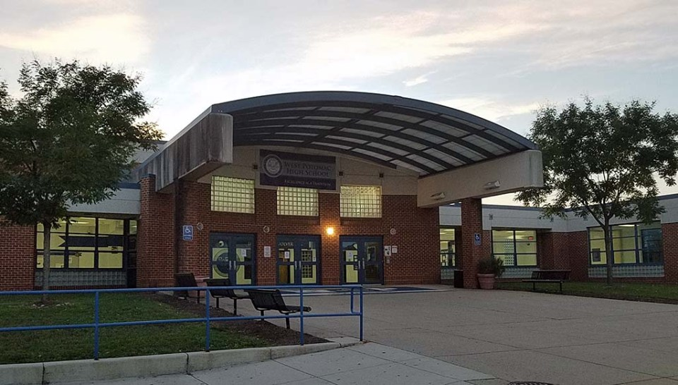 Main entrance to West Potomac High School at dusk