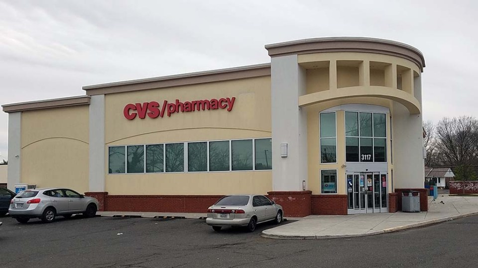 Storefront of CVS on cloudy day