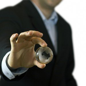 businessman-holding-crystal-globe-1236587-638x382