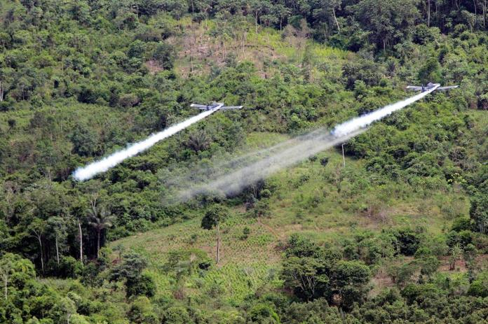 Defying U.S., Colombia Halts Aerial Spraying of Crops Used to Make Cocaine  - The New York Times