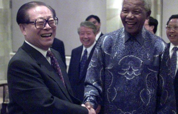 Former Chinese President Jiang Zemin greets former South African President Nelson Mandela in 2000.