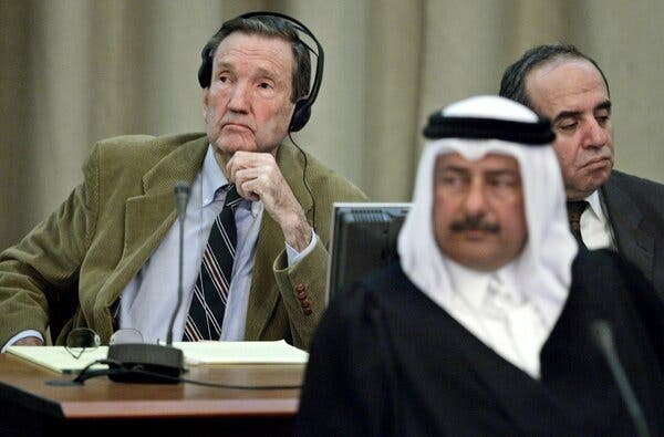 Mr. Clark at the trial of Saddam Hussein in Baghdad in 2005, with Mr. Hussein's legal advisers Najeeb al-Nauimi, center, and Issam al-Ghazzawi.