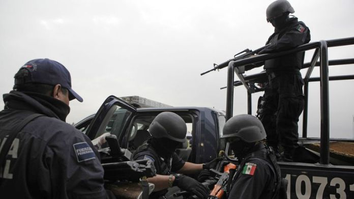 Seized weapons from alleged members of the Beltran-Leyva drug cartel are taken away by federal agents after a news conference in Mexico City on June 26, 2009.