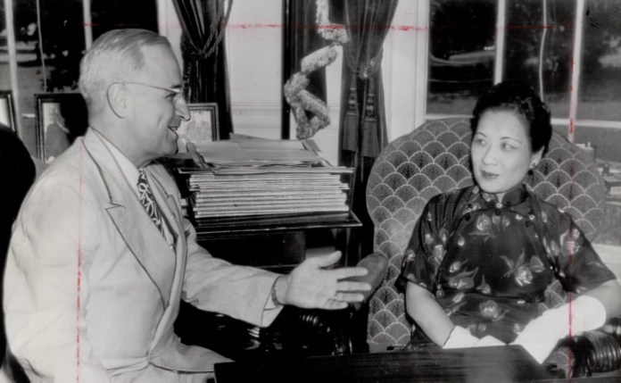 Smiles of victory and friendship are flashed here by President Truman and Mme, Chiang Kai-Shek as they meet at the White House during a visit to Washington of the wife of China's Generalissimo Chiang. They're enjoying news from the Far East