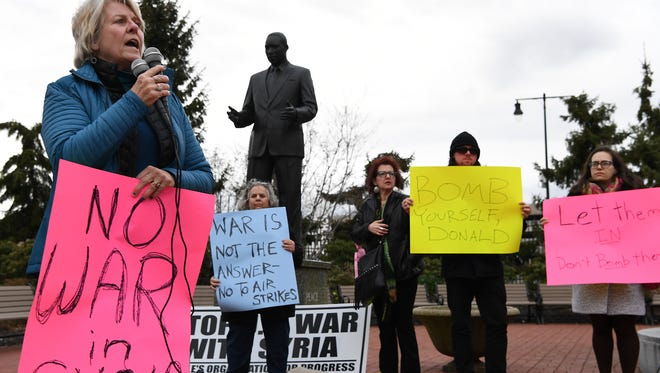 A protest against the U.S. launching of missiles into Syria on Friday, April 7, 2017, near the Martin Luther King Jr. statue in Newark.