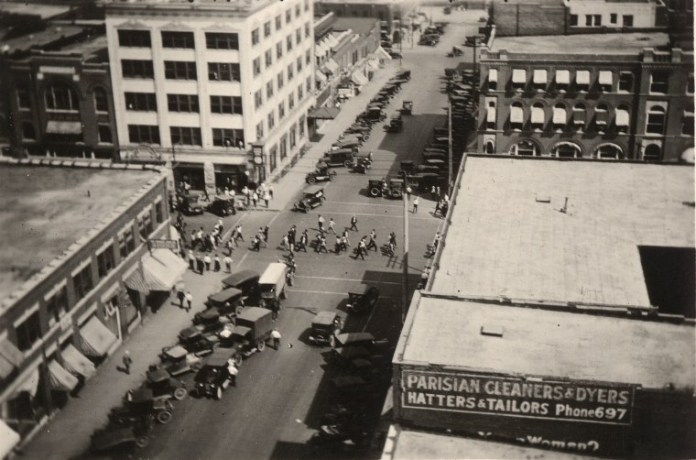 Detainees being marched through downtown Tulsa, Okla., on June 1, 1921, viewed from the roof of the Daniel Building.