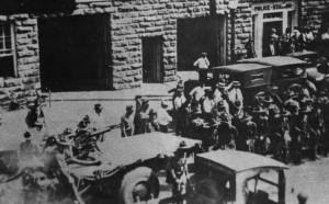 The Oklahoma National Guard arrives in Tulsa; the truck that mounted a machinegun is seen in the lower left of this rare and unique photograph.