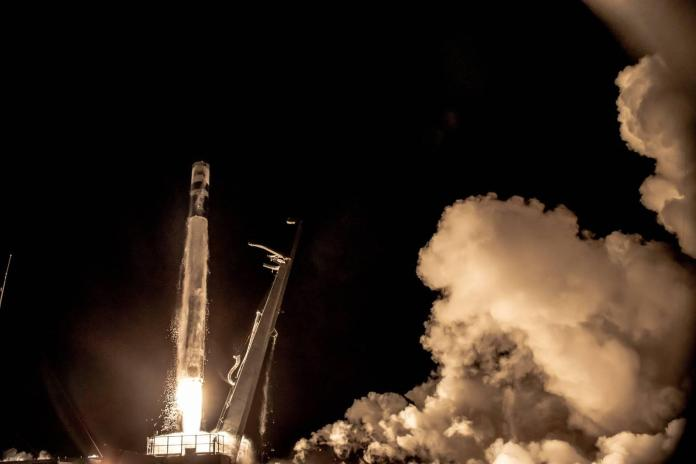 A picture containing smoke, transport, dark, rocket  Description automatically generated